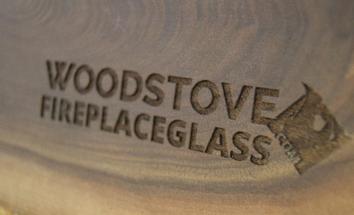 Woodstove-FireplaceGlass Logo etched in wood